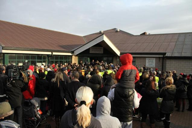 Hundreds gather outside the local community centre to register for the search for missing three-year-old Mikaeel Kular